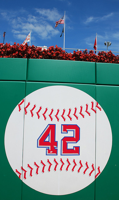 A photograph of Jackie Robinson's number 42 painted on a baseball. It is on the outfield wall of the Washington National's baseball park.