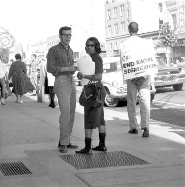 A photograph of a two anti-segregation protesters outside of a segregated business in Florida, 1960