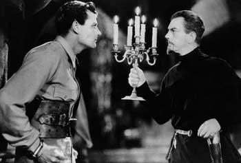 "A movie still from the film ""The Most Dangerous Game."" Shown are the main characters Rainsford and General Zaroff."