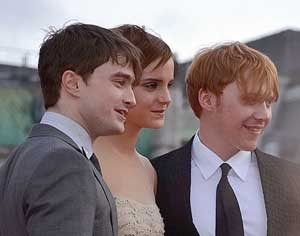 photo of the three actors who play Harry, Hermione, and Ron in the Harry Potter movies