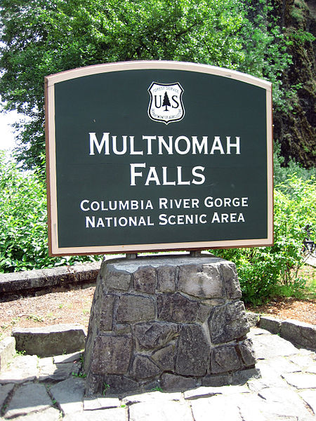 A photograph of the sign at the Multnomah Falls National Park in Oregon