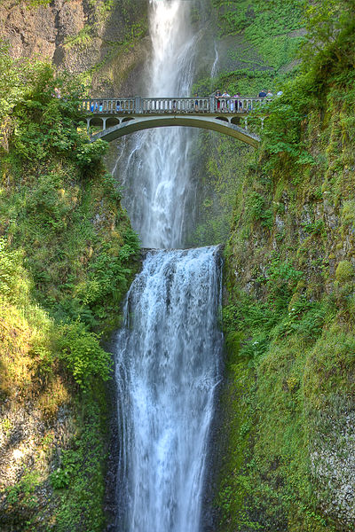 A photograph of Multnomah Falls in Oregon. In the photo is a pedestrian bridge for viewing the falls.