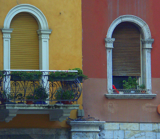 A photograph of two similar window frames on different colored walls