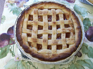 A photograph of a freshly baked peach pie