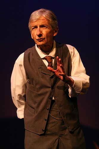 """A photograph of a man playing the part of the stage manager in the play """"Our Town"""""""
