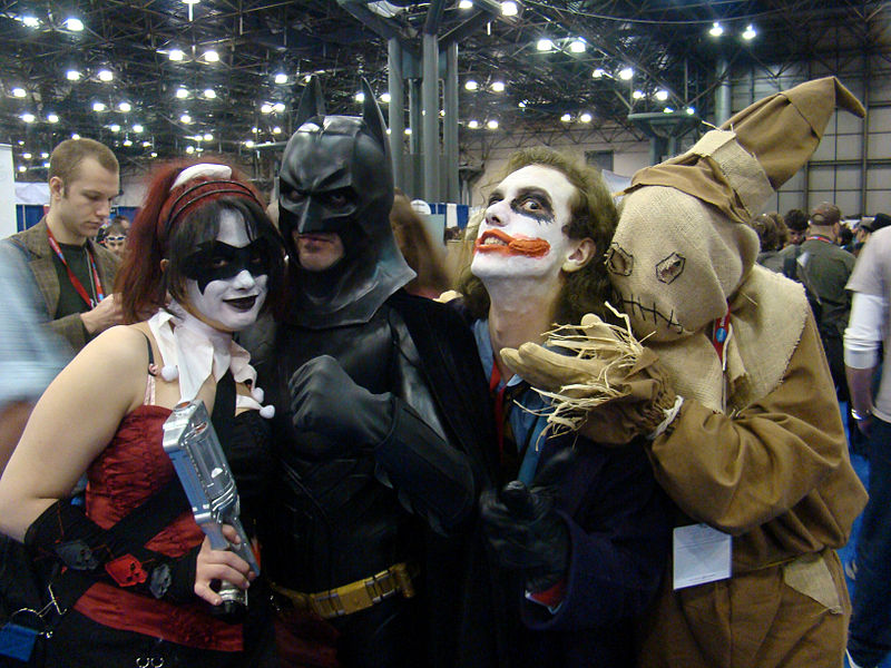 A photograph of people dressed in costumes representing Batman and several villains including the Joker