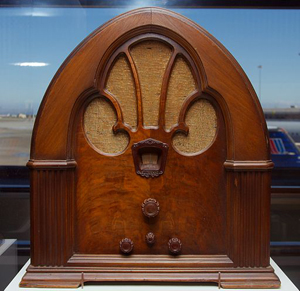 A photograph of an antique wooden radio