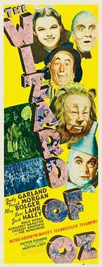A poster form the movie The Wizard of Oz. All of the main characters are shown: Dorothy, the Scarecrow, the Cowardly Lion, the Tin Man, and the Wizard.