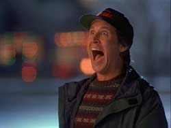 A photograph of the actor Chevy Chase screaming maniacally