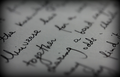 A close up photograph of sentences written in a notebook