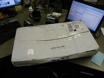 A photograph of a delivered package sitting on a desk