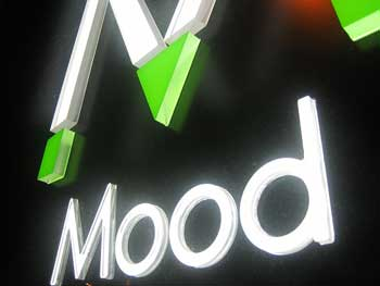 """A photograph of a lighted sign that reads: """"Mood."""""""