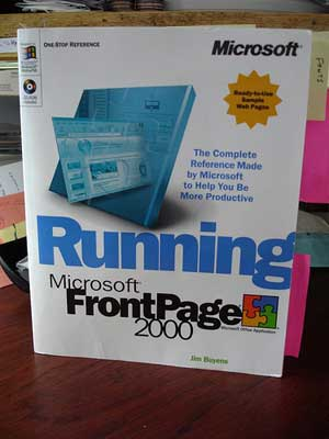 A photograph of a product manual: Running Microsoft Front Page 2000.