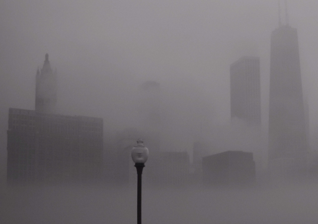 A photograph of the Chicago skyline enveloped in fog