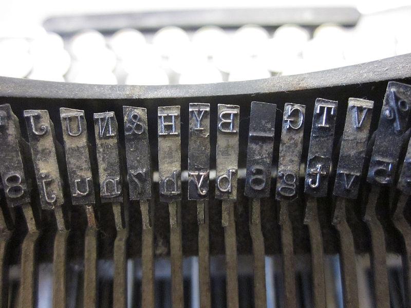 photo of the backside of several typewriter keys