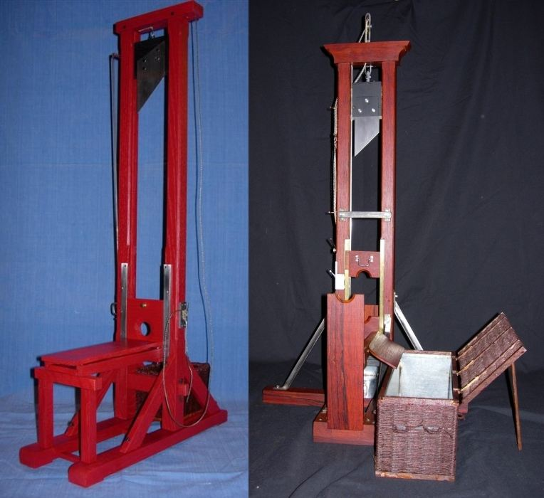 Two photos that show a red guillotine from the front and side. The blade is raised at the top of vertical shaft, and there is a bench for the doomed person to rest their chest on so that their head can be put through the shaft.
