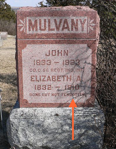 "Photo of tombstone that reads: Mulvaney, John, 1833–1923, military designation, Elizabeth A., 1832–1910, Gone But Not Fergotton. The ""For"" in ""Forgotten"" is misspelled with an ""e"". It should be an ""o""."