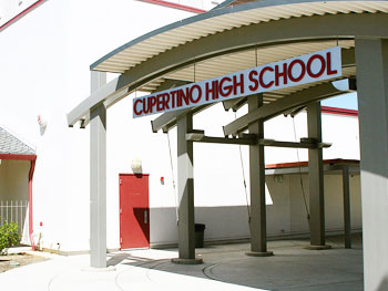 """Photo of """"Cupertino city limit"""" sign with speed limit sign above it—""""35"""""""