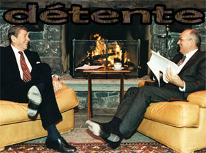warm scene at a meeting between two leaders. Ronald Reagan and Mikhail Gorbachev smile at each other as they talk in front of a fireplace.