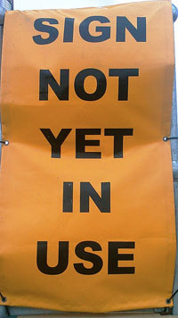 "A photograph of a sign that reads: ""Sign Not Yet in Use"""