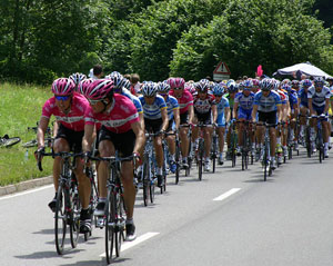 A photograph of cycling teams on a road during a leg of the Tour de France race