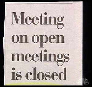 "A newspaper heading that reads ""Meeting on open meetings is closed."""