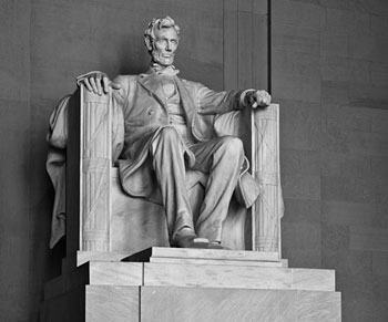 A photograph of the seated statue of President Abraham Lincoln at the Lincoln Memorial in Washington, D.C.