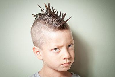 headshot of a boy with classic Mohawk hairdo