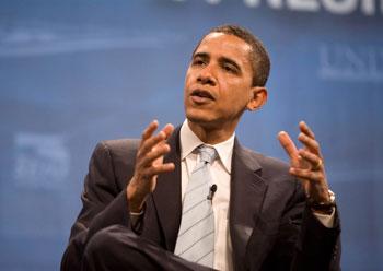 Barack Obama gesturing as he speaks.