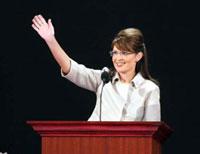 Photo of Sarah Palin waving from a podium.