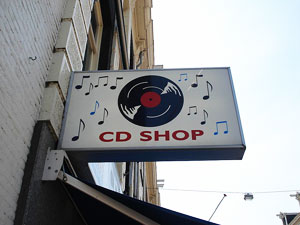 """Image of store sign that says """"CD Store"""" with an image of a old style vynil record"""