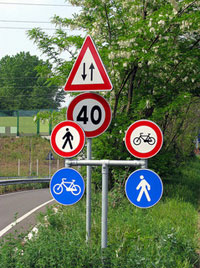 Image signage on road indicating pedestrian and bicycle traffic