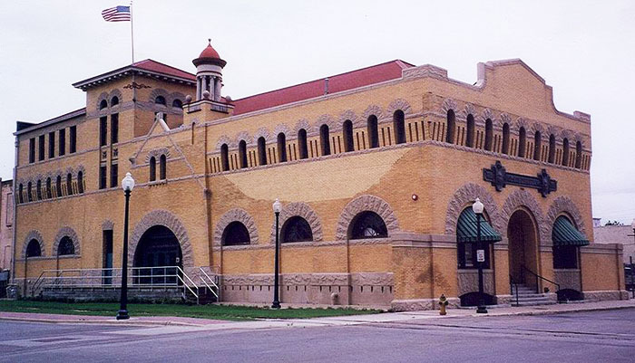 The Dr. Pepper Museum in Waco, Texas illustrates a stout building with a roof, walls, bricks, and mortar.