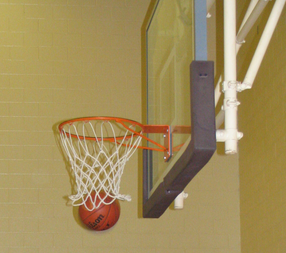 a photograph of a basketball going through the hoop