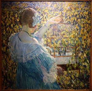 A colorful impressionist painting shows a young woman holding a bird cage with green and yellow birds in it.