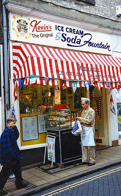 A photograph of the exterior of an old fashioned Ice Cream Parlor and Soda Fountain.