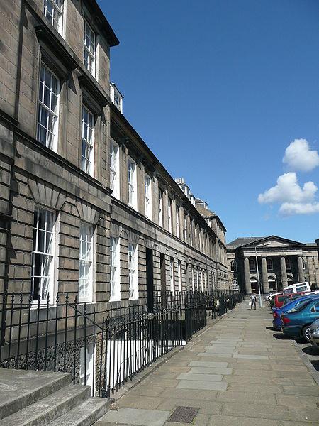 A photograph of a sidewalk in downtown Edinburgh, Scotland