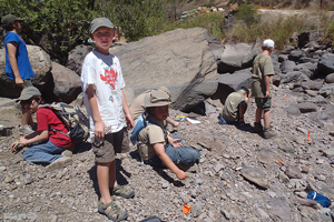 A photograph of campers resting a long a trail.