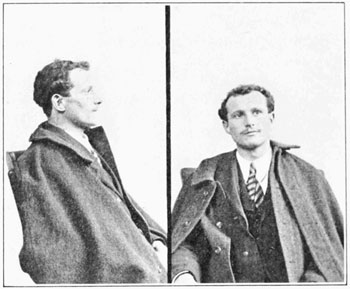 A photograph of an Italian immigrant from the 1920s.The man is young and wearing a suit and an overcoat.