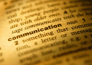 Close up picture of the word communication in a dictionary