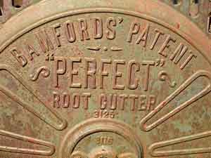 "photo of iron wheel that reads ""Bamford's Patent 'Perfect' Root Cutter"""