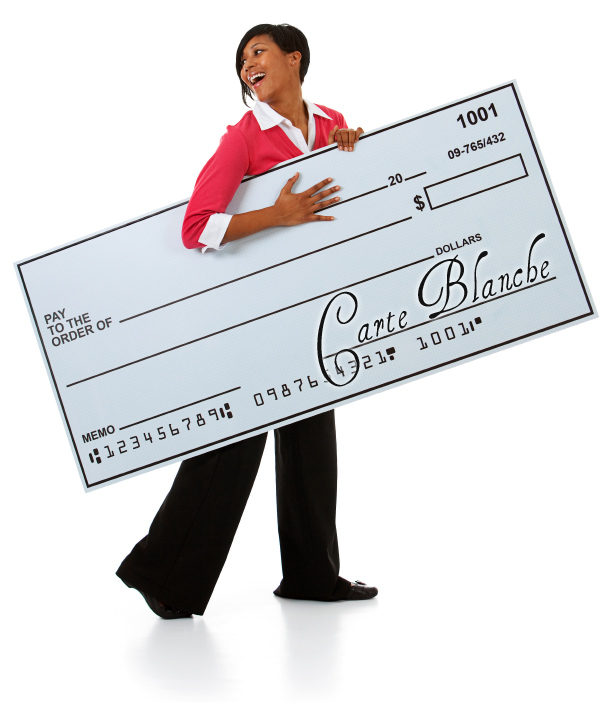 Woman holding a giant blank check.