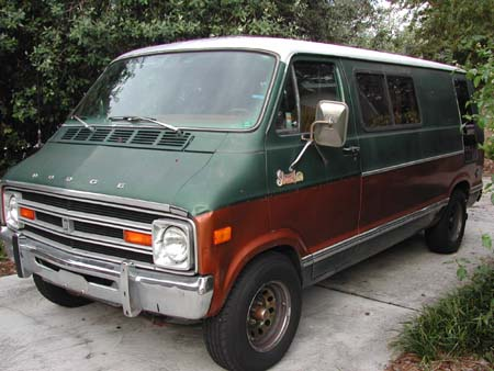 A photograph of a 1070s Dodge Van.