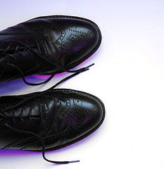 A photograph of a pair of men's wingtip shoes