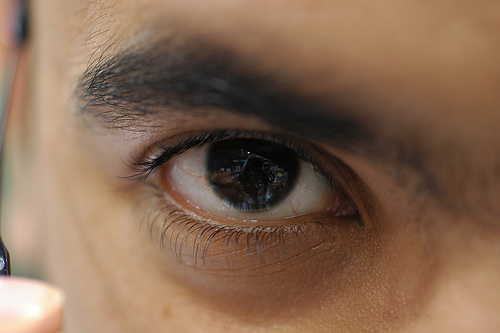 A close up photograph of a man's eye
