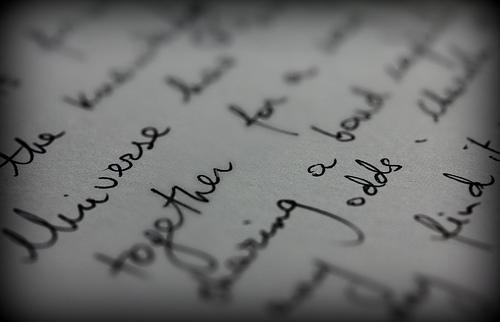 A close up photograph of sentences written in a notebook