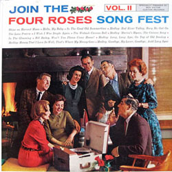 An old-looking album shows a group of adults, mostly in their forties and fifties, singing around an old record player. They are wearing suits and ties, nice dresses and pearls.