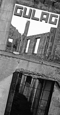 A stark black and white image form Alcatraz, showing an abandoned and decayed concrete prison block.