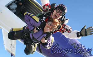 An older couple sky-dives out of a plane.