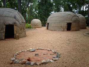 A photograph of a recreated 17th century village at the Jamestown Settlement in Virginia